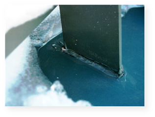 Example of a waterproofing failure in a mechanically-attached (non-penetrating) snow guard system