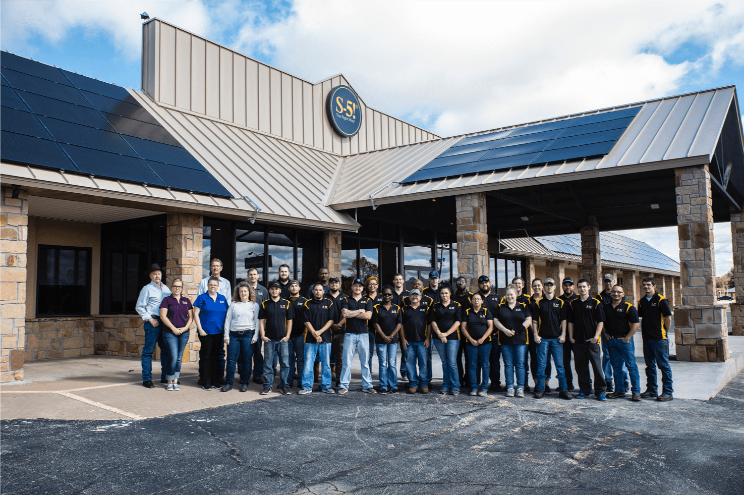S-5!® Manufacturing plant staff outside exterior of facility-min